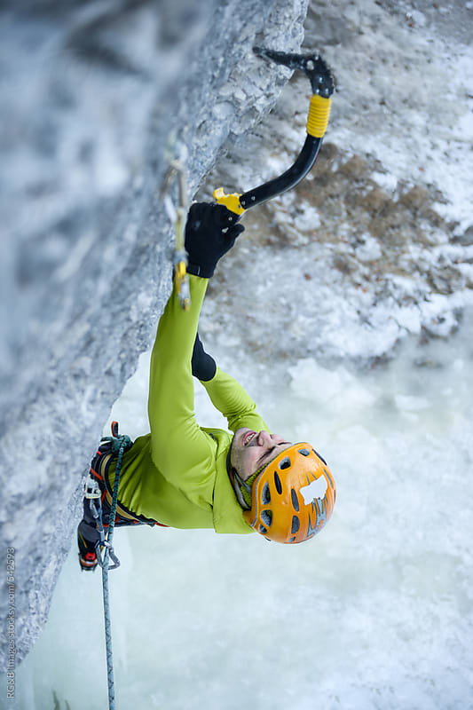 Man climbing with ice axes  by RG&B Images for Stocksy United