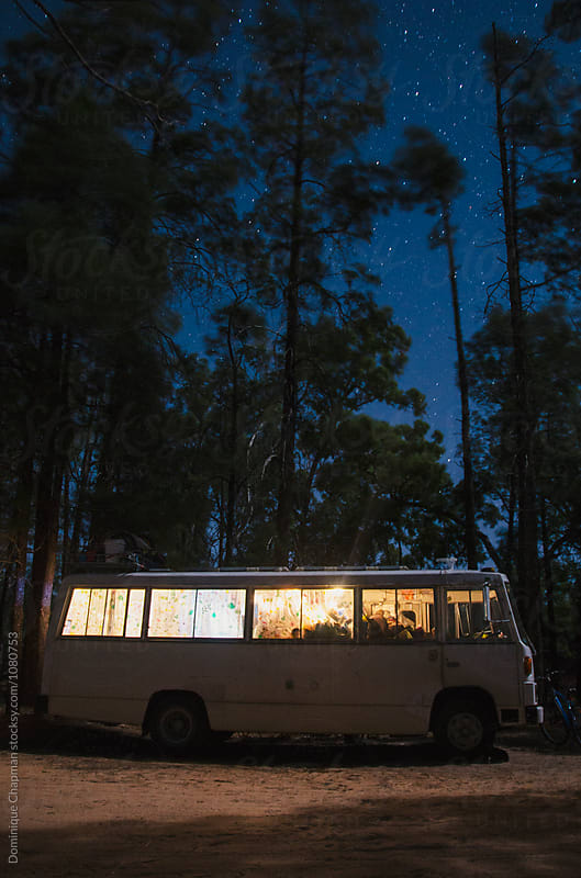 Motorhome parked in a forest at night by Dominique Chapman for Stocksy United