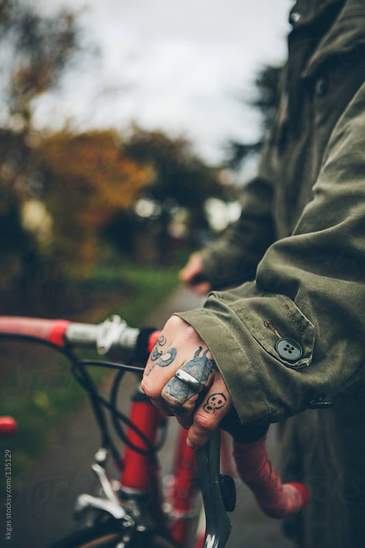 Close up of mans hands on a bicycle by kkgas for Stocksy United