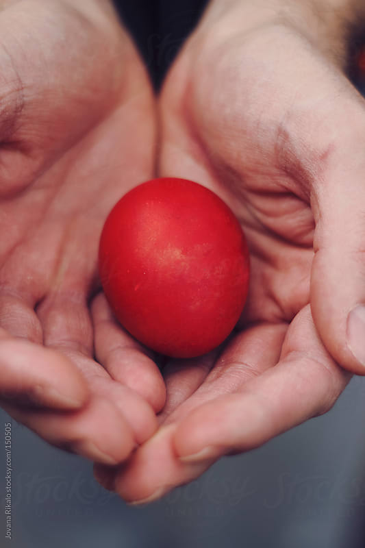 Easter egg in man's hands by Jovana Rikalo for Stocksy United