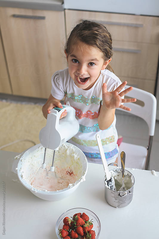Child making cake by Dejan Ristovski for Stocksy United
