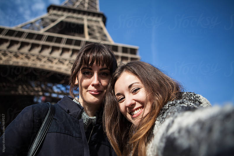 Happy young women taking a selfie under the Eiffel tower, Paris. by kkgas for Stocksy United