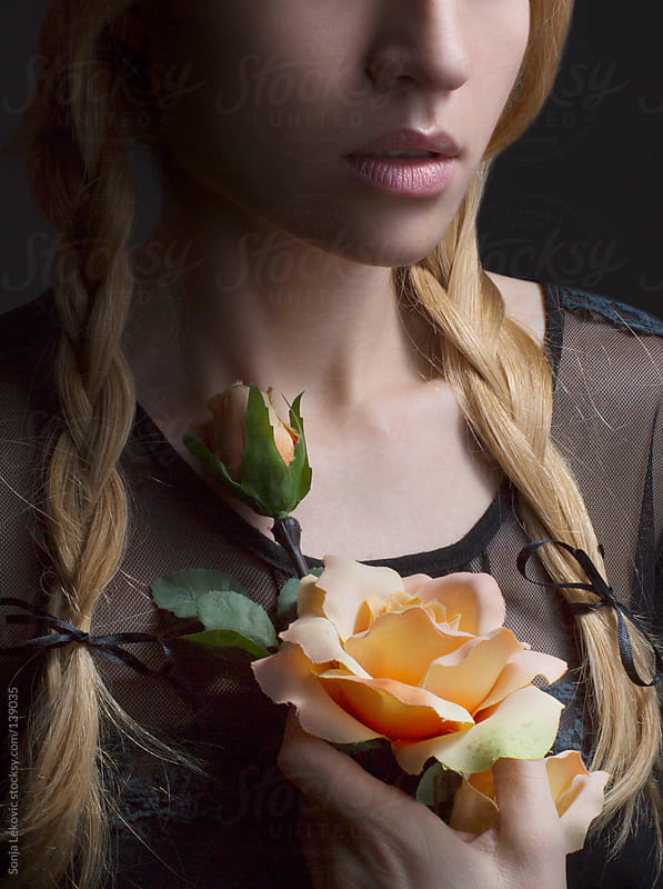 woman with a rose by Sonja Lekovic for Stocksy United