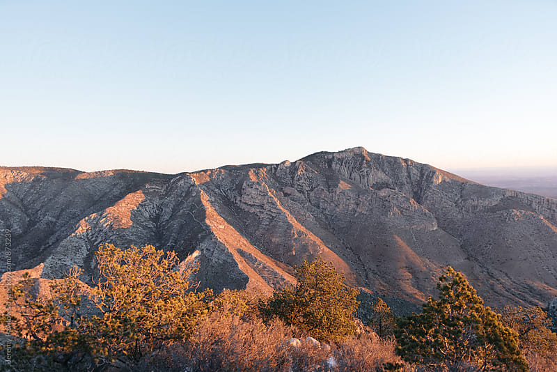 Mountains in the morning sunlight while hiking, Texas. by Jeremy Pawlowski for Stocksy United