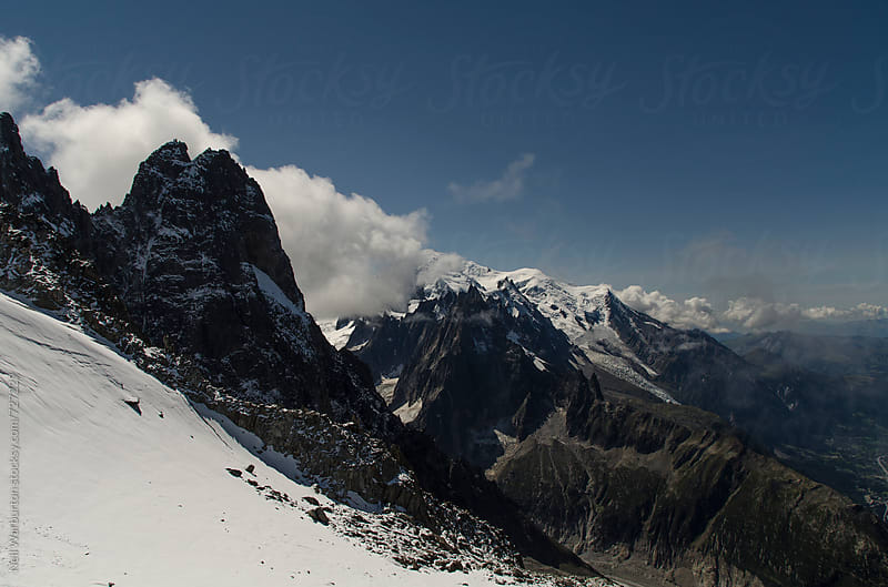 Les Dru and distant peaks in the French alps by Neil Warburton for Stocksy United