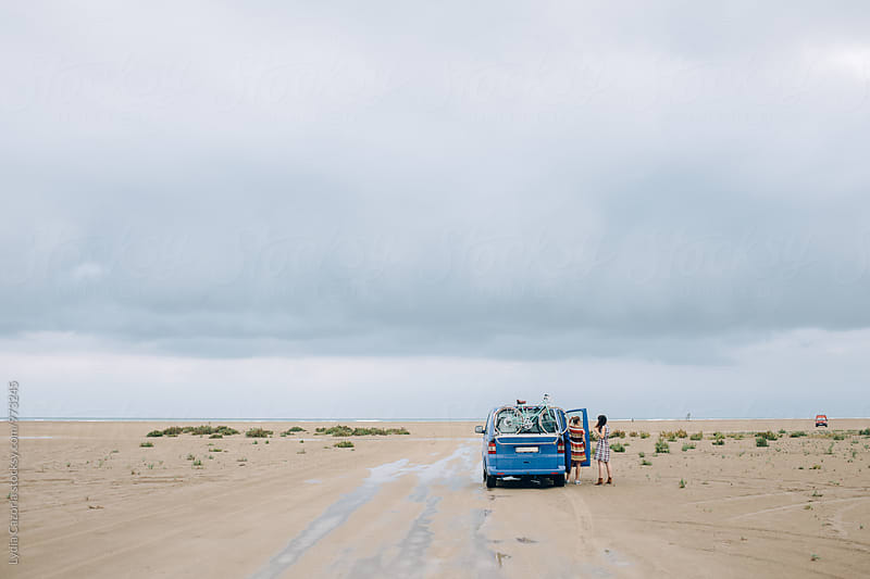Girls on a travel for the beach with a van  by Lydia Cazorla for Stocksy United