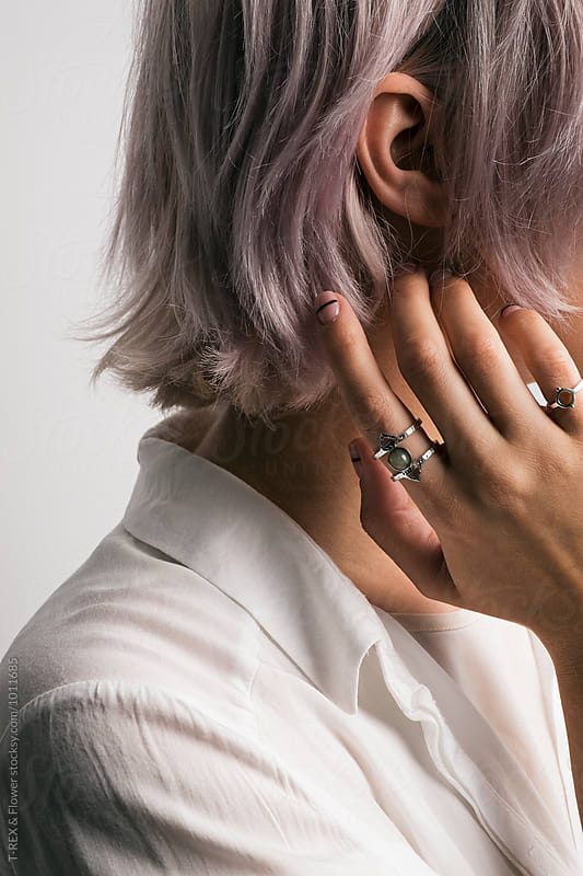Close-up of pink-haired girl touching neck with manicured nails by Danil Nevsky for Stocksy United