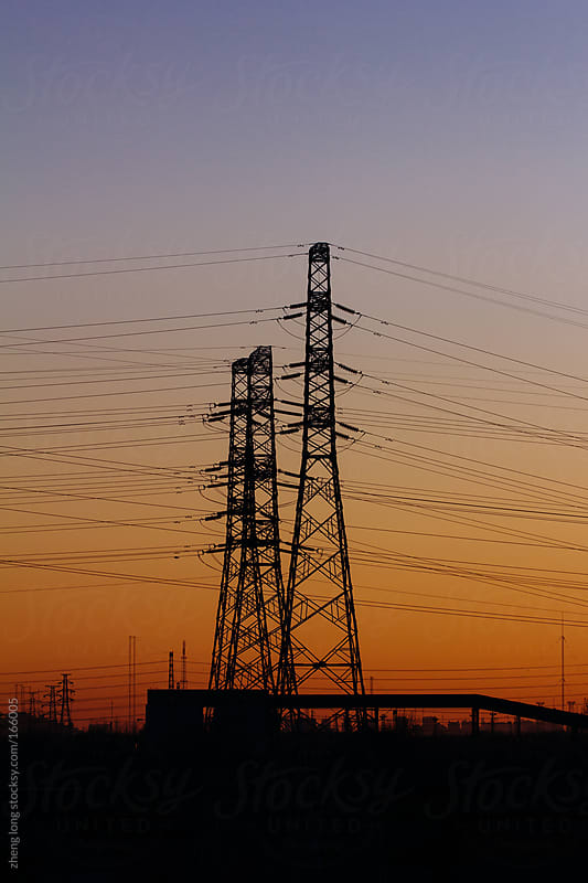 Electric tower when sunrise by zheng long for Stocksy United