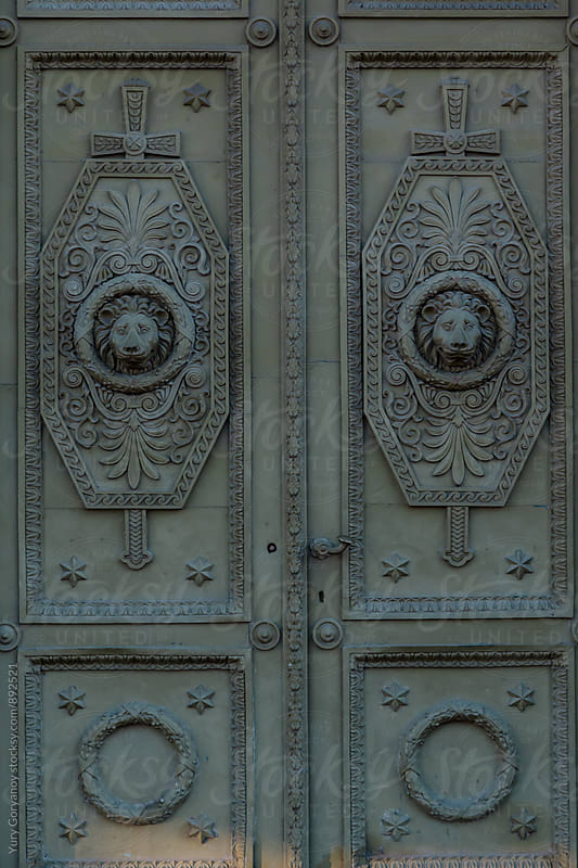Door with an ornament and a decorative lion head by Юрий Горяной for Stocksy United
