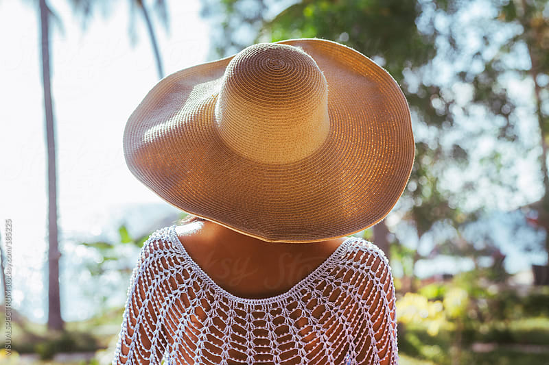 Woman Wearing Straw Hat From Behind by VISUALSPECTRUM for Stocksy United