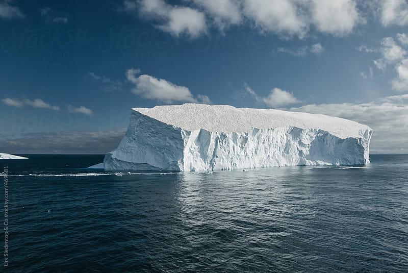 Iceberg floating on Antarctic Ocean by Urs Siedentop & Co for Stocksy United