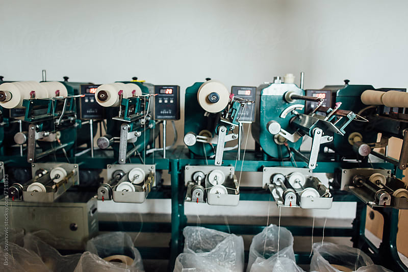 Thread winding machine in work by Boris Jovanovic for Stocksy United