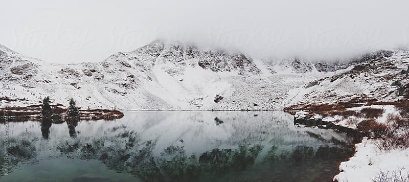 Snowy Rocky Mountain Reflective Lake by Kevin Russ for Stocksy United