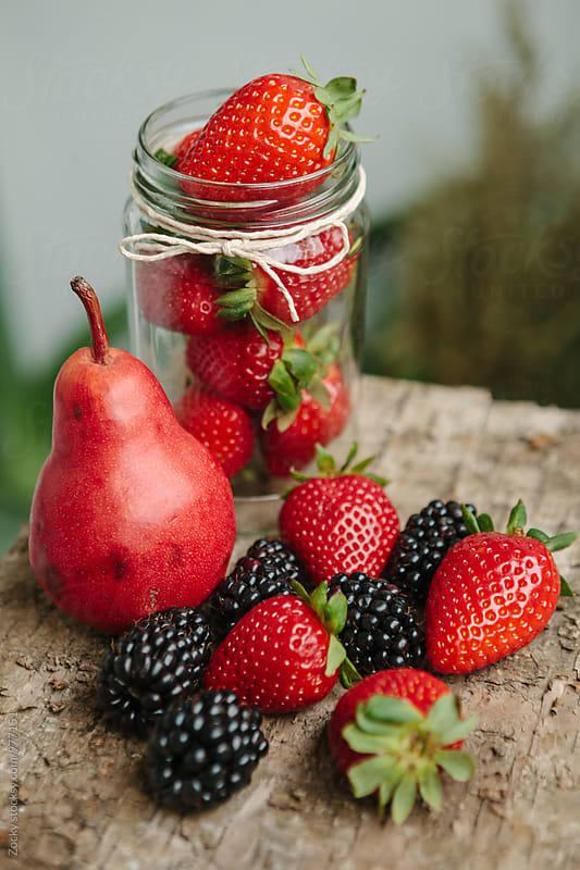 Fruit in a glass jar by Zocky for Stocksy United