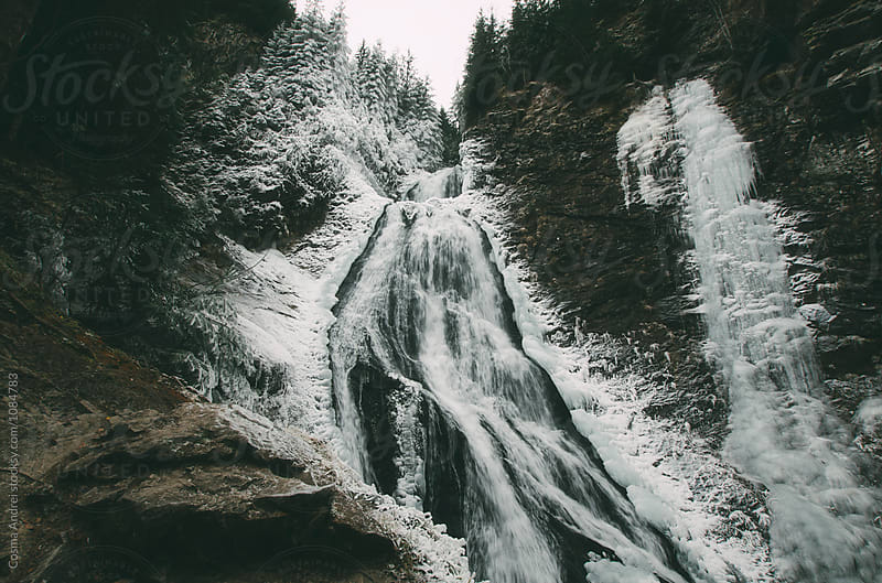 Winter waterfall by Cosma Andrei for Stocksy United