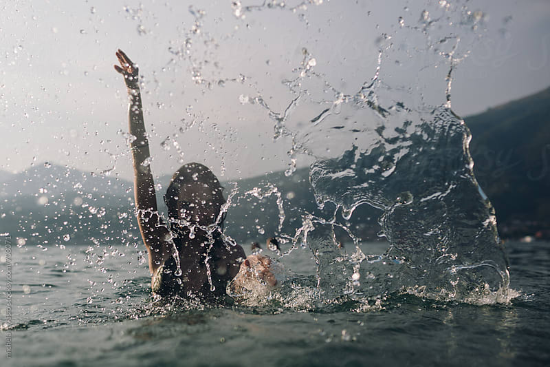 Splashing water in summer at the lake by michela ravasio for Stocksy United