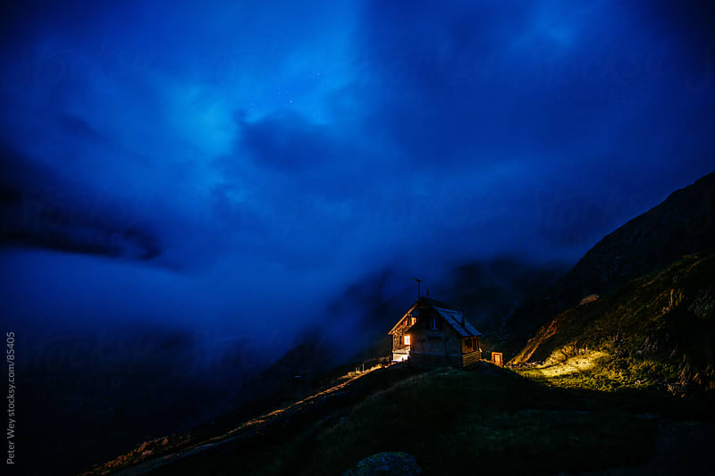 Panorama with Gauli SAC mountain hut after nightfall by Peter Wey for Stocksy United