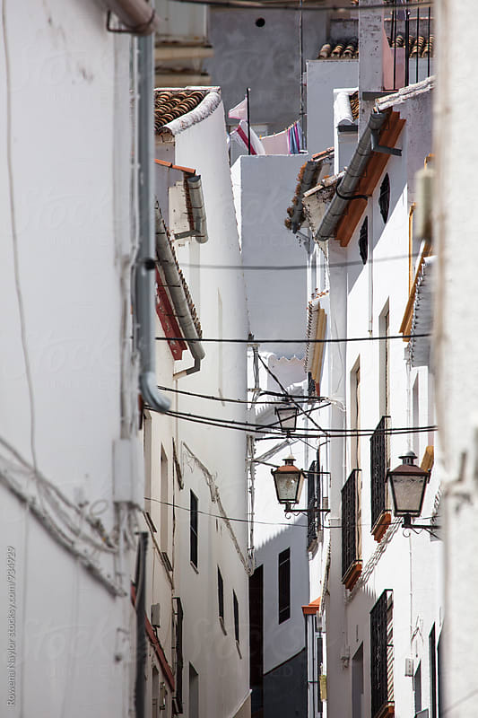 Narrow streets of Spanish village by Rowena Naylor for Stocksy United