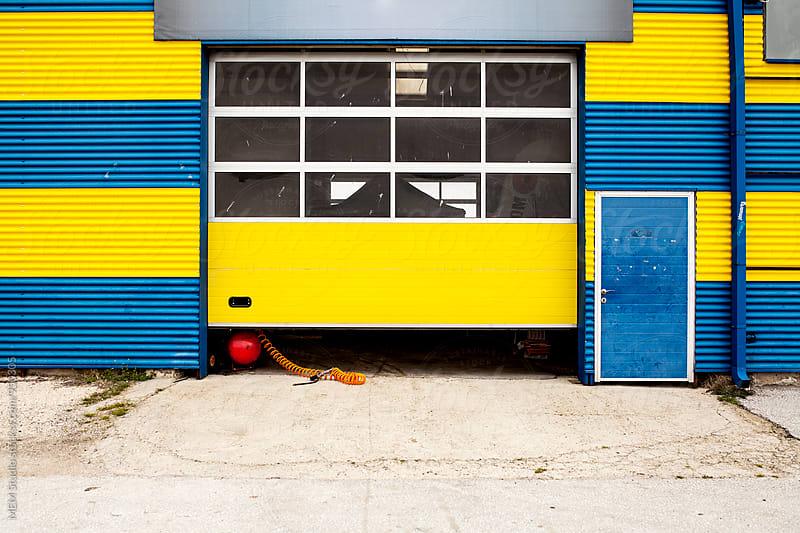 yellow garage by MEM Studio for Stocksy United