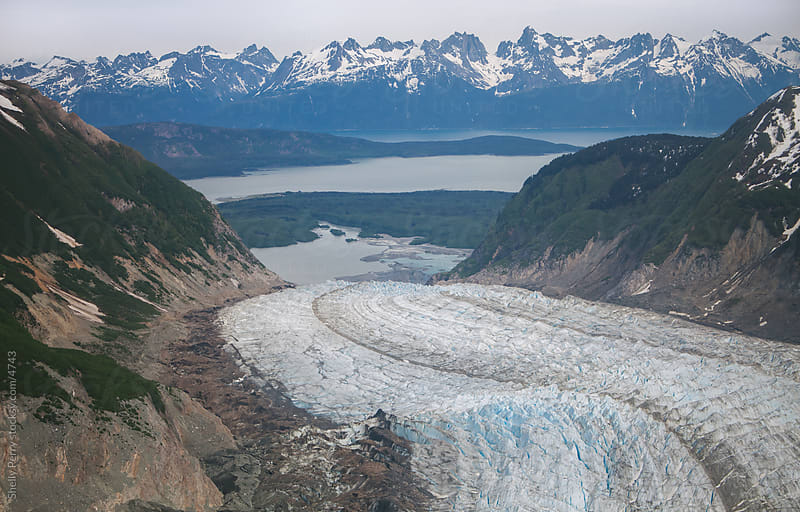 A glacier during summer in Alaska from above by Shelly Perry for Stocksy United