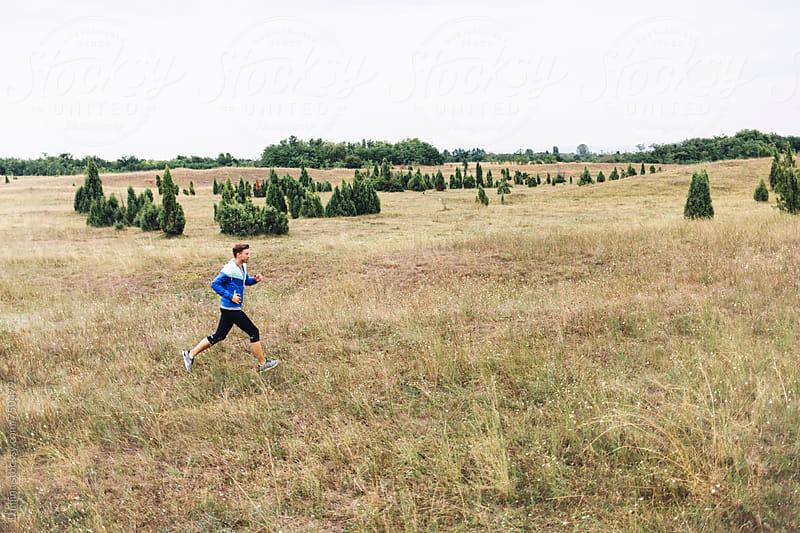 Caucasian Man in Sportswear Jogging by Lumina for Stocksy United