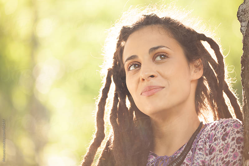 Outdoor portrait of a woman with dreadlocks. by Mosuno for Stocksy United