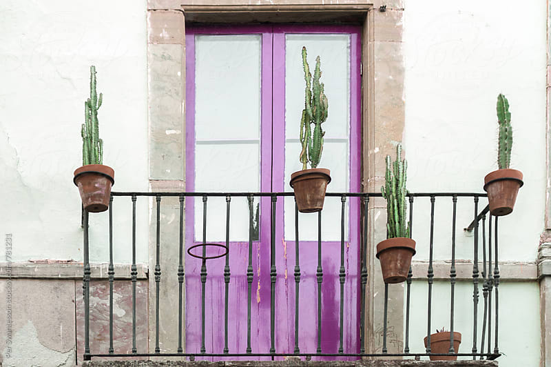 Colorful purple balcony by Per Swantesson for Stocksy United