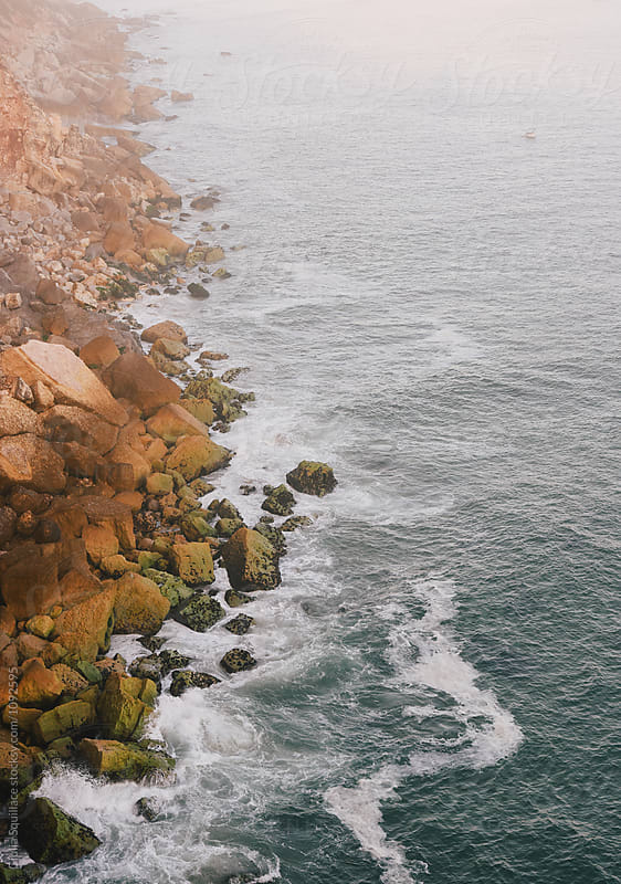 Waves and rocks in a misty day by Giulia Squillace for Stocksy United