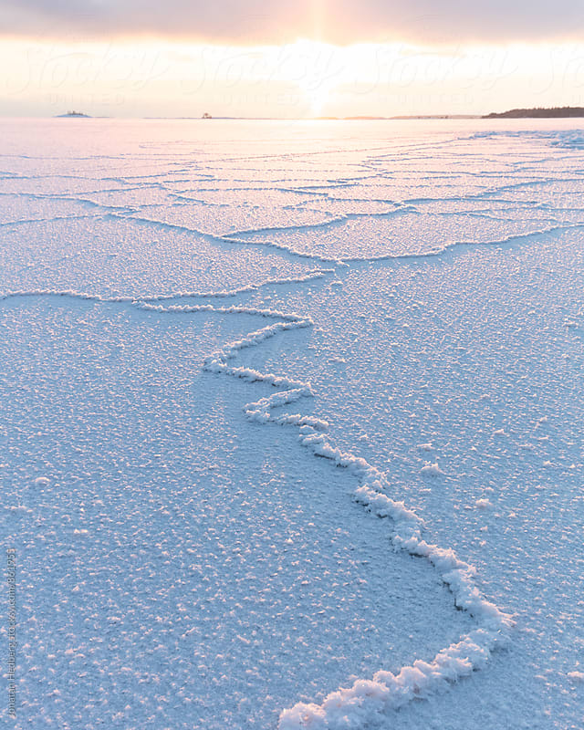 Frozen cracks in the sea ice by Jonatan Hedberg for Stocksy United