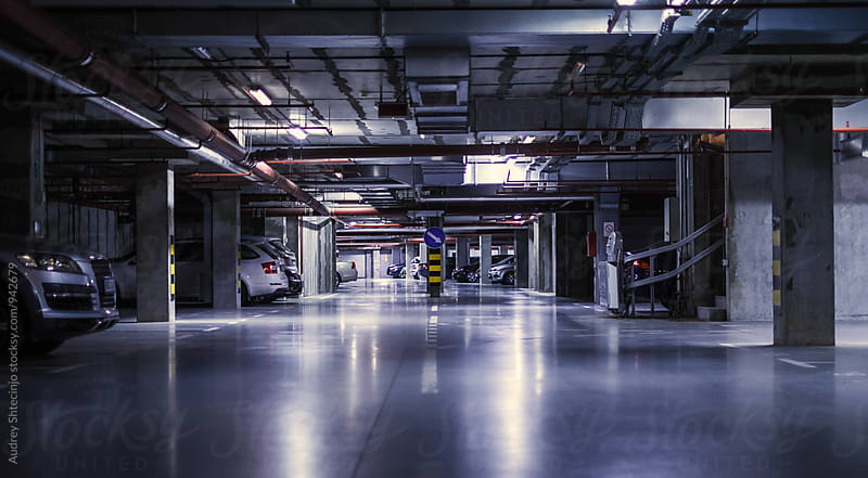 Undergorund parking/garage with neons -perspective by Marko Milanovic for Stocksy United