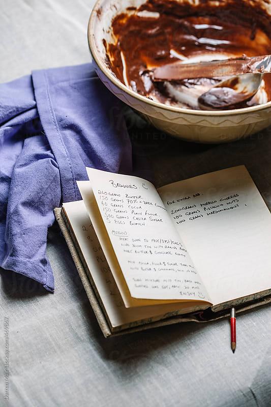 Chocolate brownie recipe in handwritten recipe book. by Darren Muir for Stocksy United