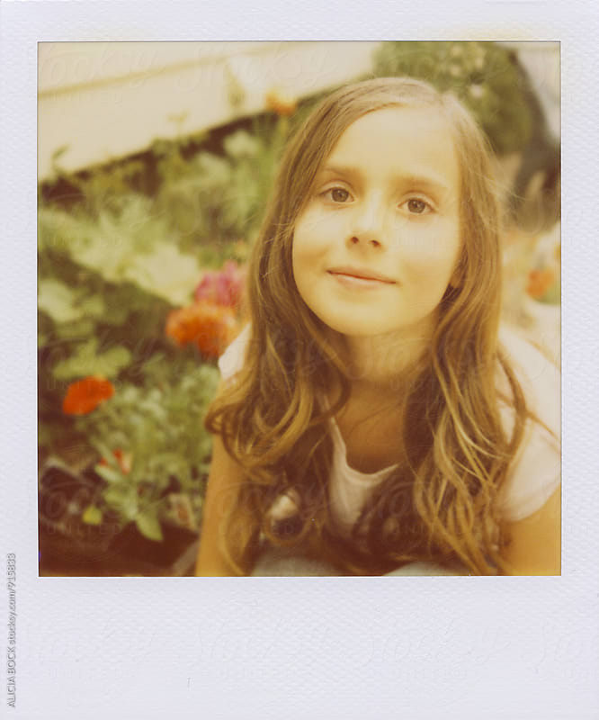 Polaroid Portrait Of A Girl Planting Flowers In A Spring Garden by ALICIA BOCK for Stocksy United