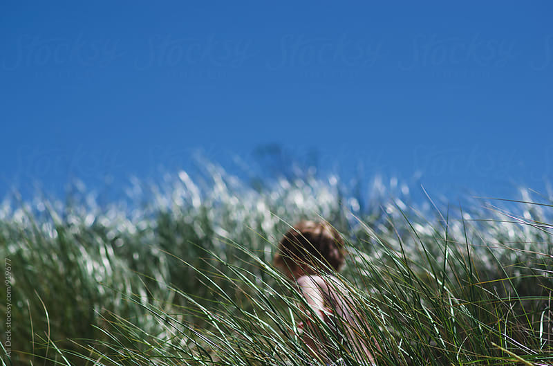 Boy in Grass by Ali Deck for Stocksy United