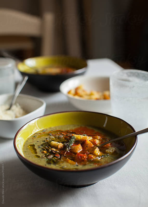 Mixed vegetable soup with croutons by Davide Illini for Stocksy United