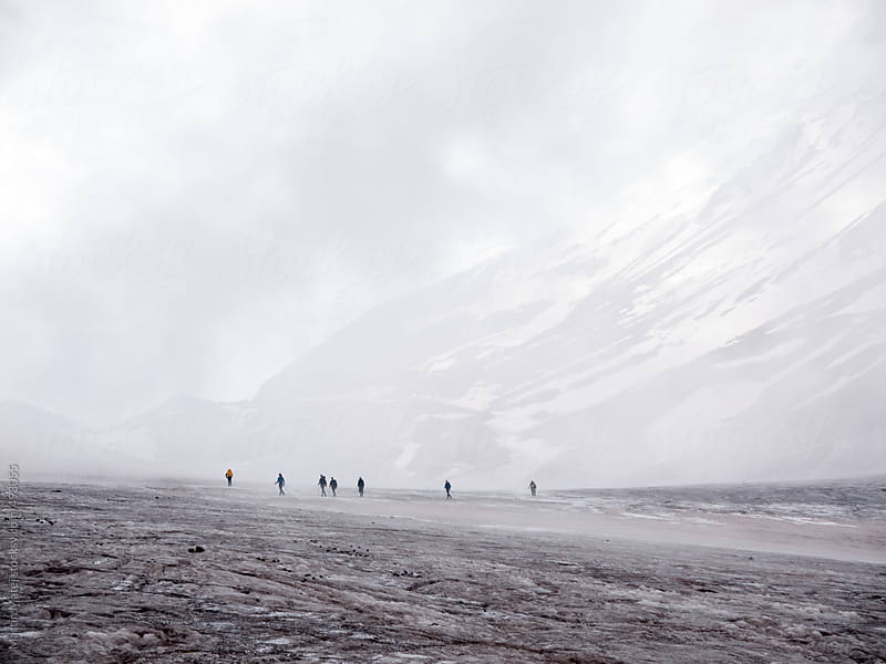 Team of mountaineers on the glacier in long distance by Martin Matej for Stocksy United