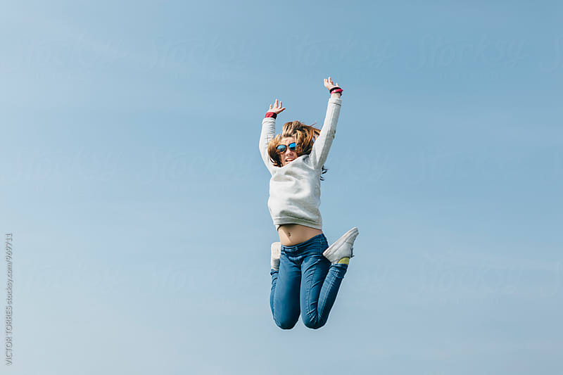 Young Girl Jumping in the Air by Victor Torres for Stocksy United