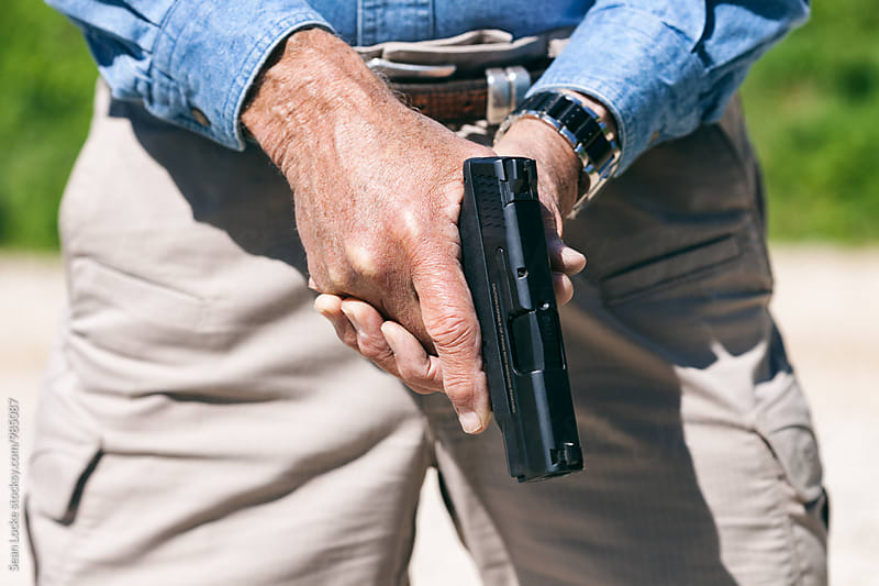 Shooting: Man Holding Pistol By Waist by Sean Locke for Stocksy United