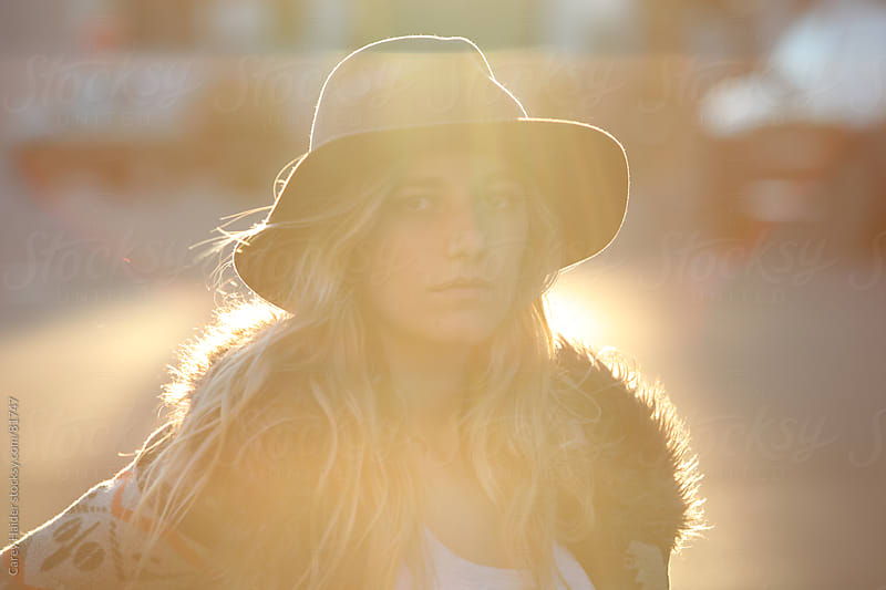 Young College Studen Female Back Lit By The Sun by Carey Haider for Stocksy United