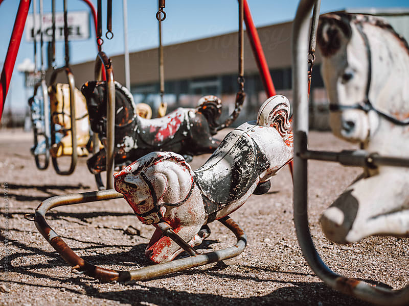 A broken, vintage horse swing set by Joseph West Photography for Stocksy United