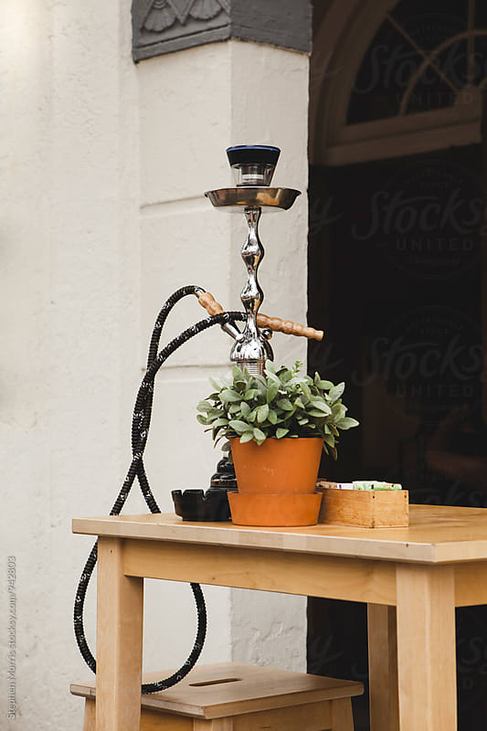 Hookah Pipe on Table by Stephen Morris for Stocksy United