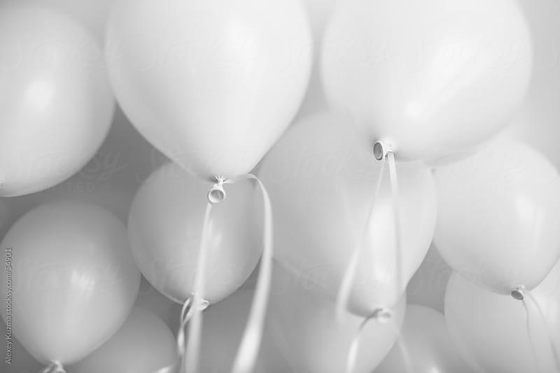 white  pastel balloons by Alexey Kuzma for Stocksy United