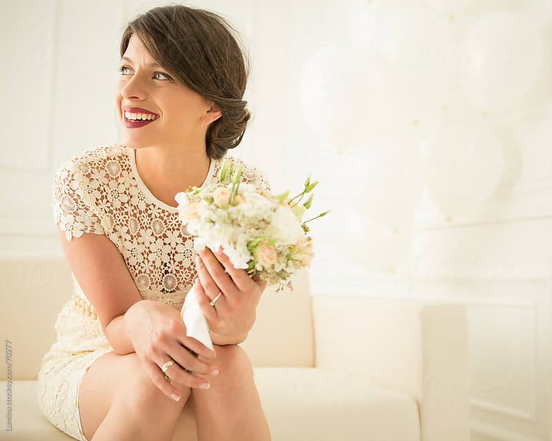 Bride Sitting With Her Bouquet by Lumina for Stocksy United