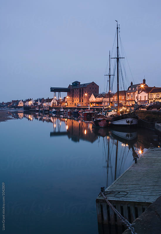 Boats and harbour at dawn twilight. Wells-next-the-sea, Norfolk, UK. by Liam Grant for Stocksy United