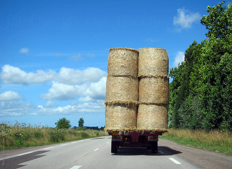Haybales on the road by Marcel for Stocksy United