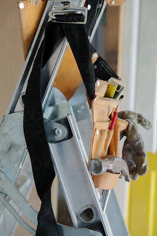 Tool belt with tools on a step ladder by kkgas for Stocksy United