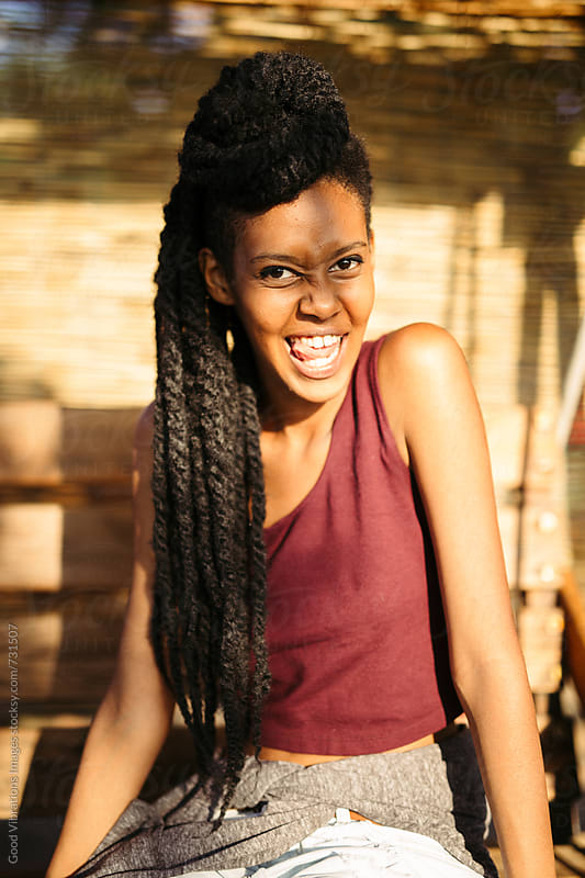 Smiling woman with Dreadlocks by Good Vibrations Images for Stocksy United