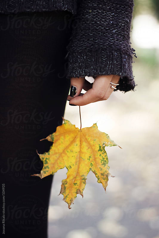 Girl holding leaf in her hand by Jovana Rikalo for Stocksy United