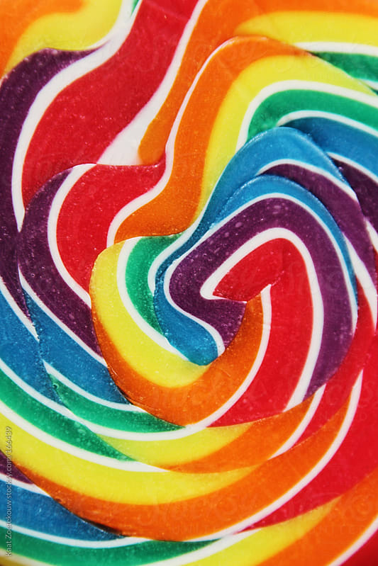 Closeup of a very colorful swirly lollipop  by Kaat Zoetekouw for Stocksy United