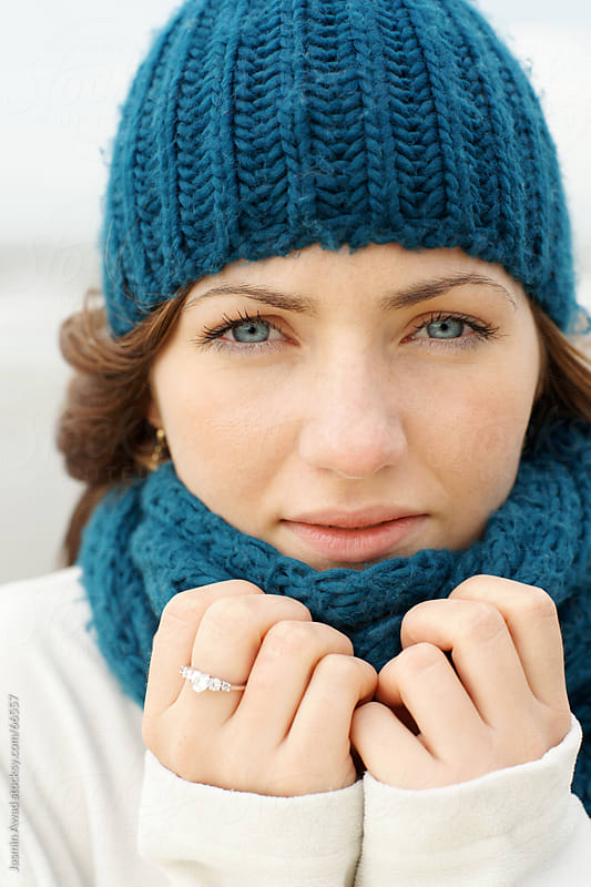 Young woman at the beach in winter Portrait by Jasmin Awad for Stocksy United