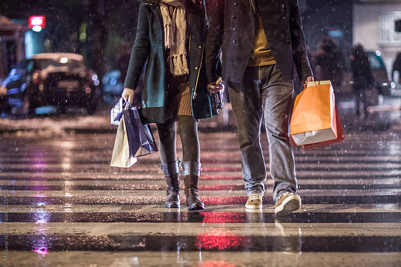 Couple After Christmas Shopping by Mosuno for Stocksy United